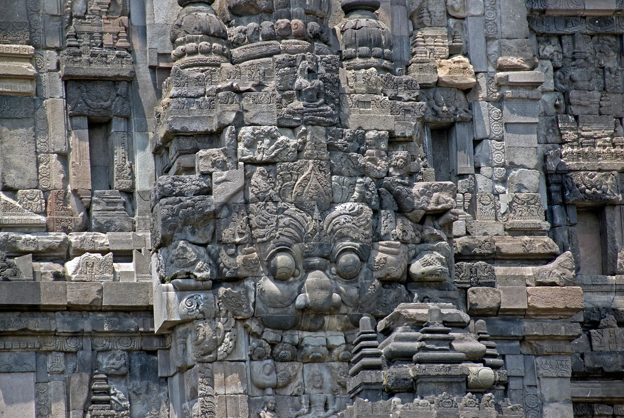 Carved faces on the walls of Prambanan temple in Java, Indonesia