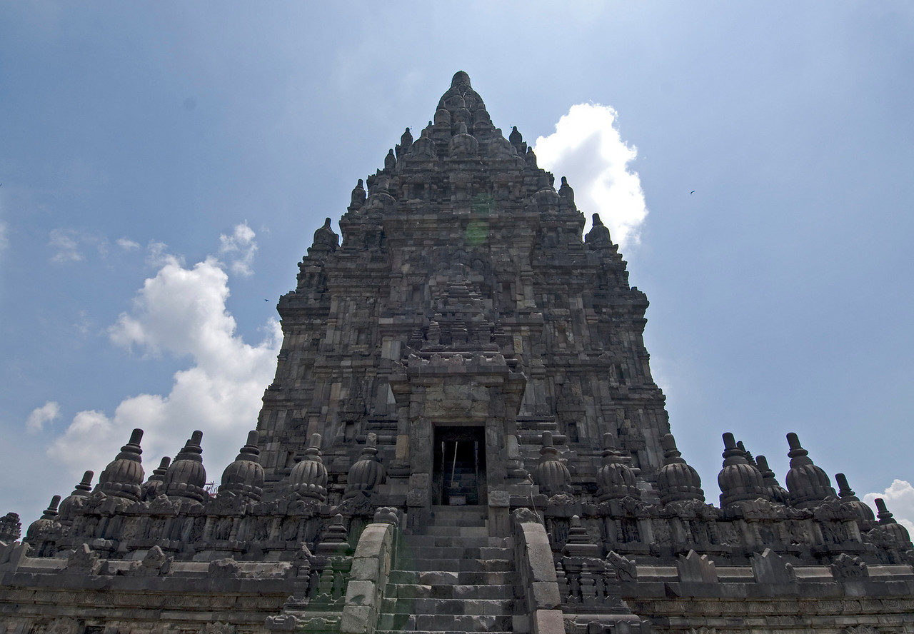The facade of Prambanan against beautiful blue sky in Java, Indonesia