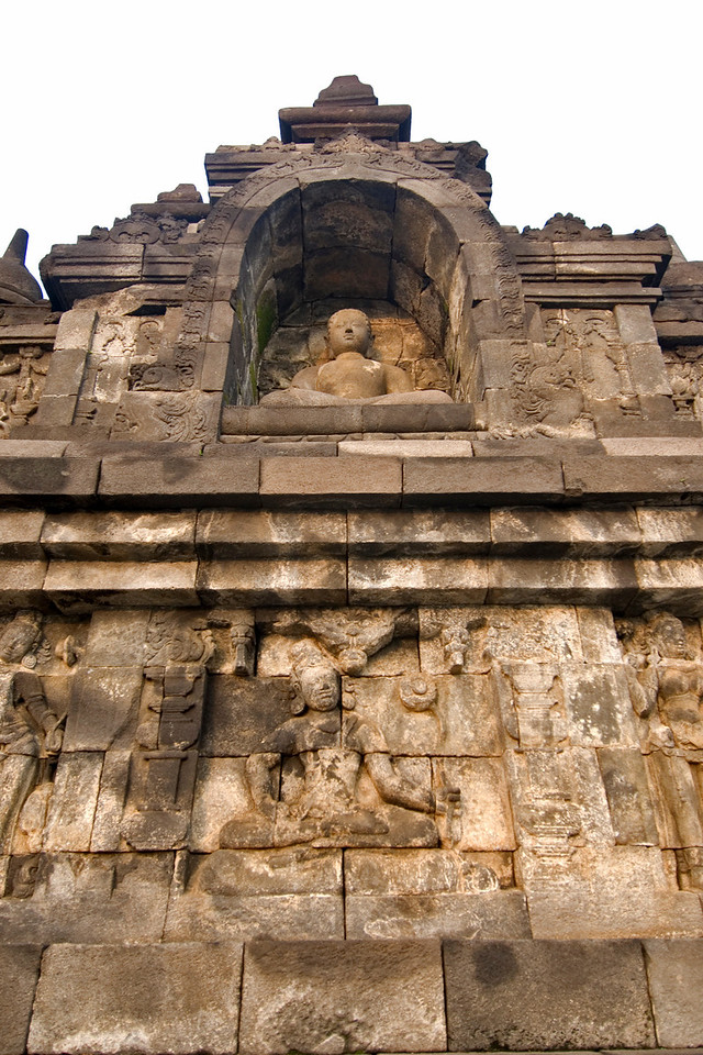 Looking up a statue of Buddha at Borobudur temple in Indonesia