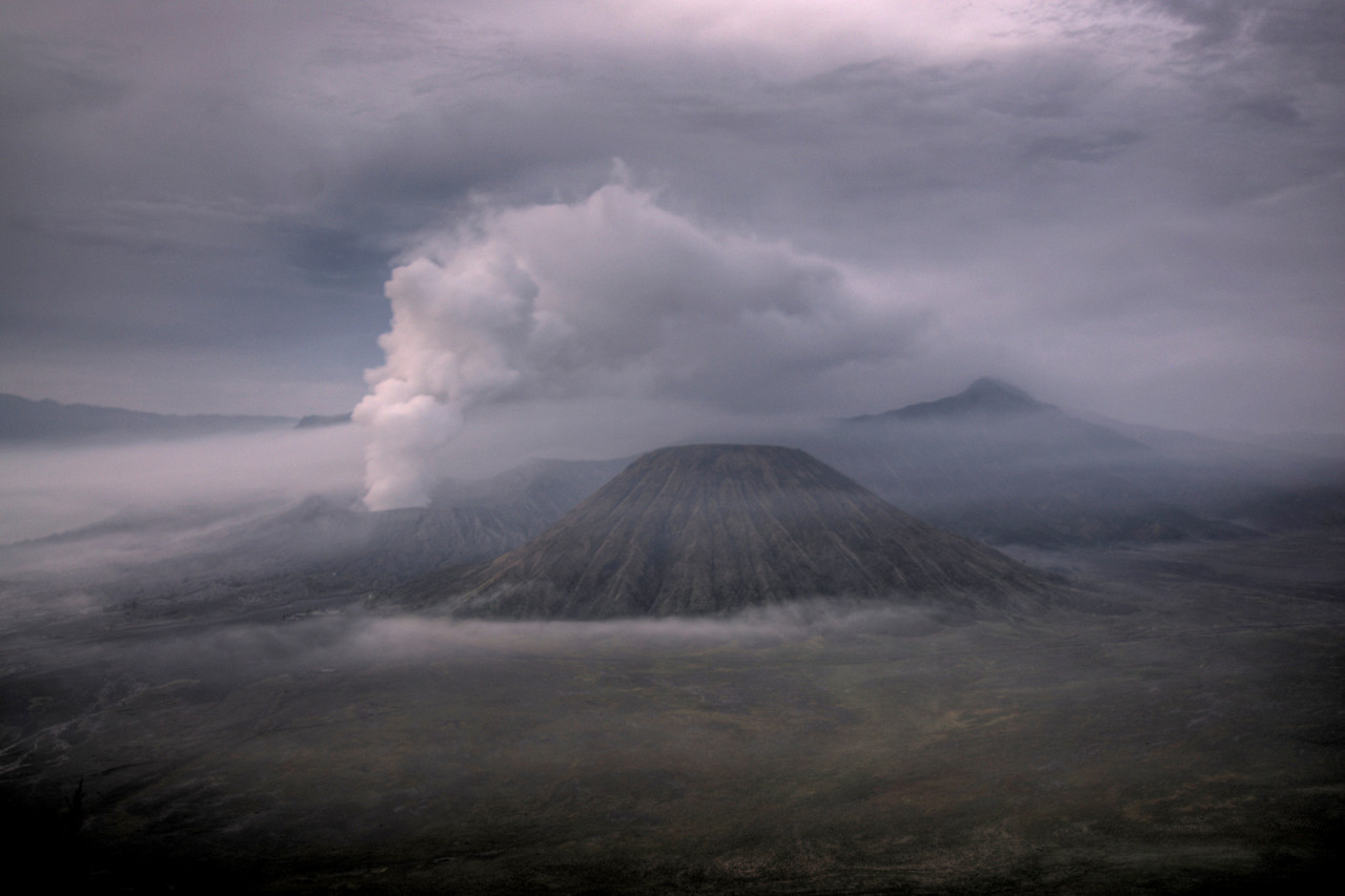 Enhanced shot of Mount Bromo with fogs and clouds covering it