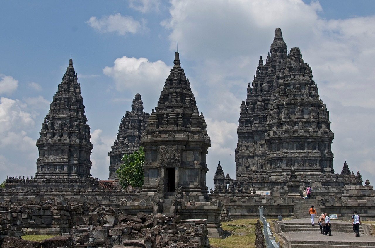 Shot of the Prambanan towers with people checking out the ruins below