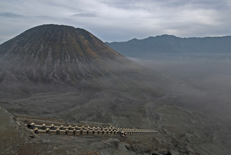 Stairs leading to Mount Bromo crater with volcano in the background