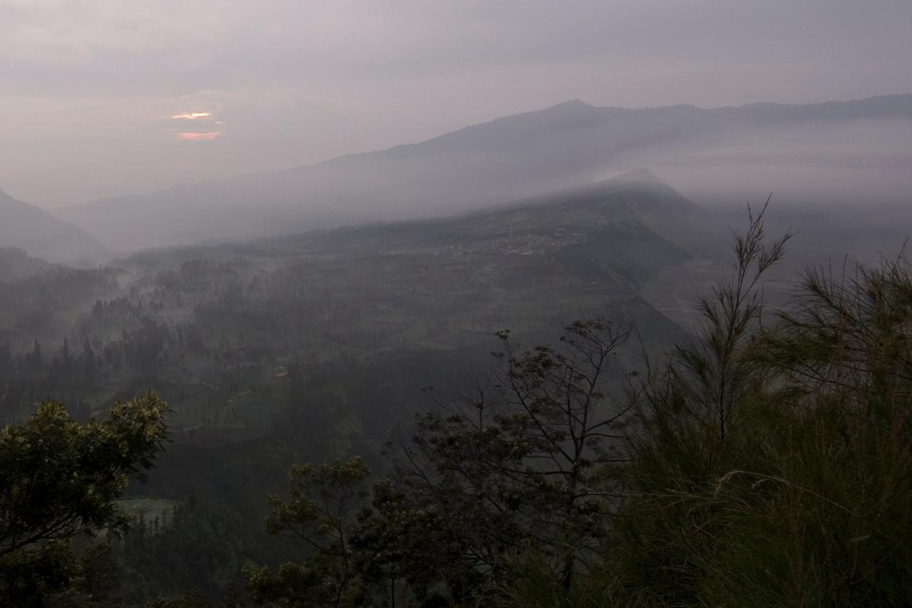 Beautiful sunrise on foggy sky at Mount Bromo in Indonesia