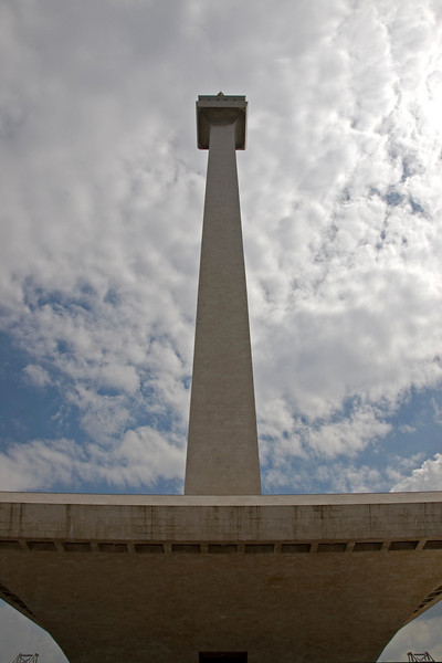 Looking up the National Monument against clear sky in Jakarta, Indonesia