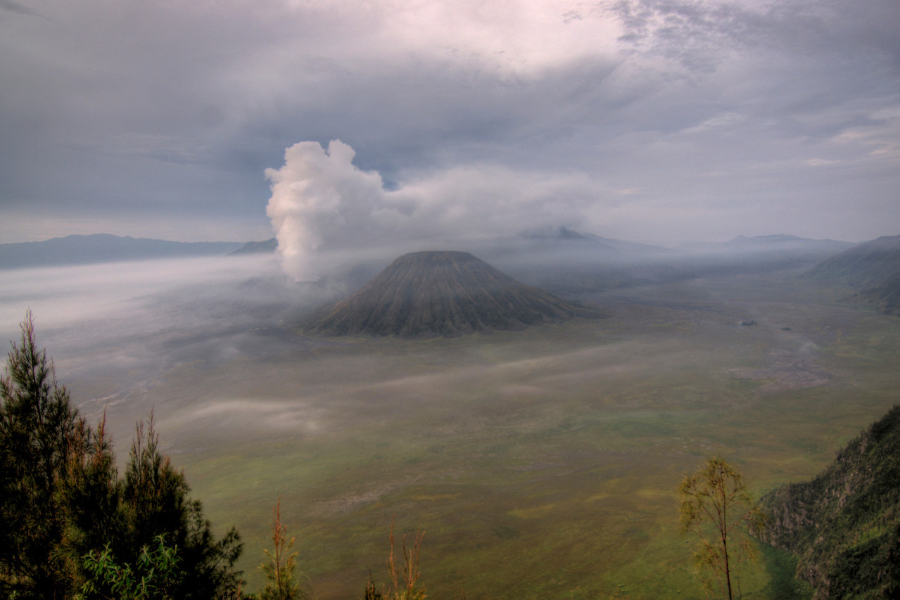 Big clouds hovering over Mount Bromo in Java, Indonesia