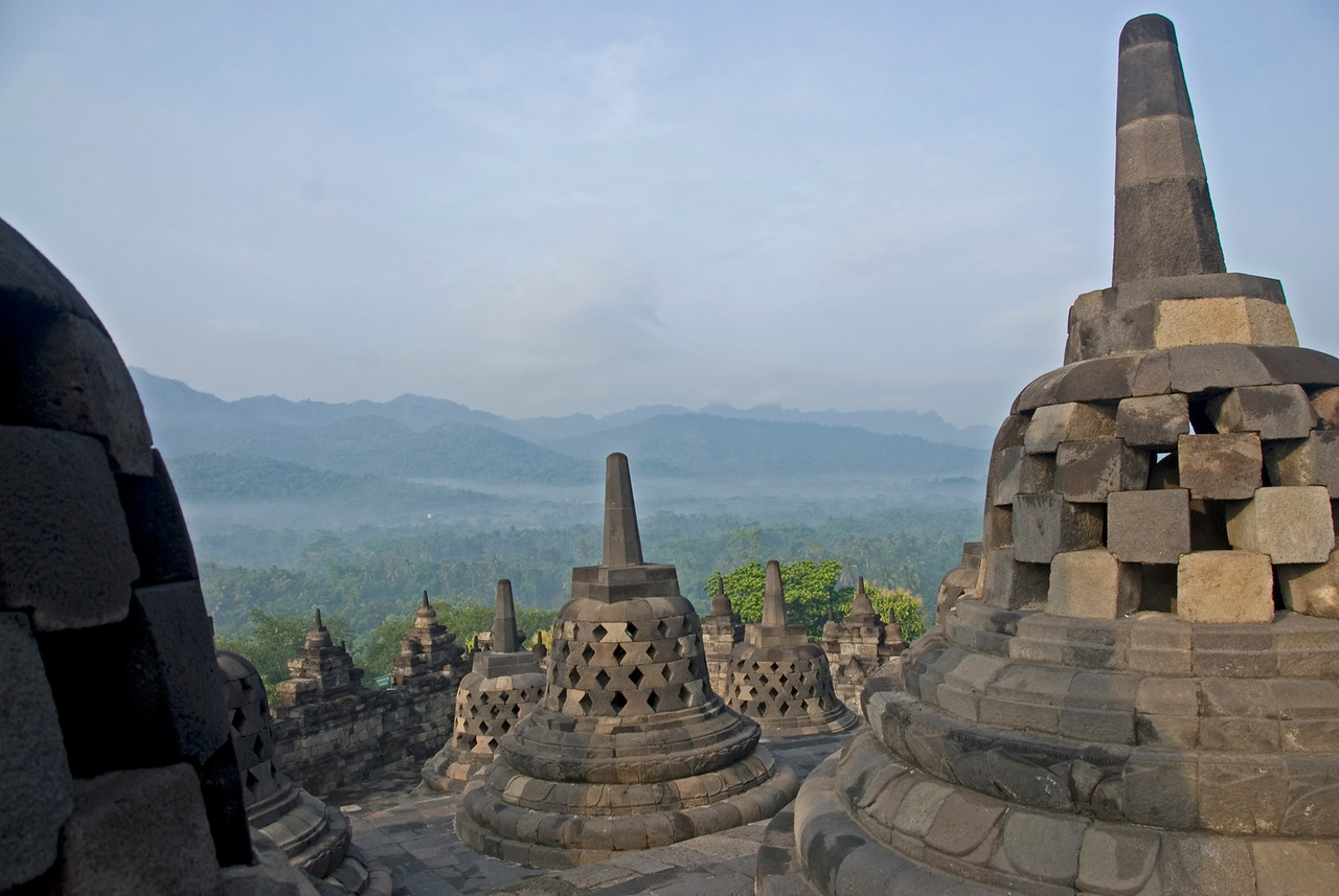 Stupas overlooking the hills atop the Borobudur temple ruins in Java, Indonesia