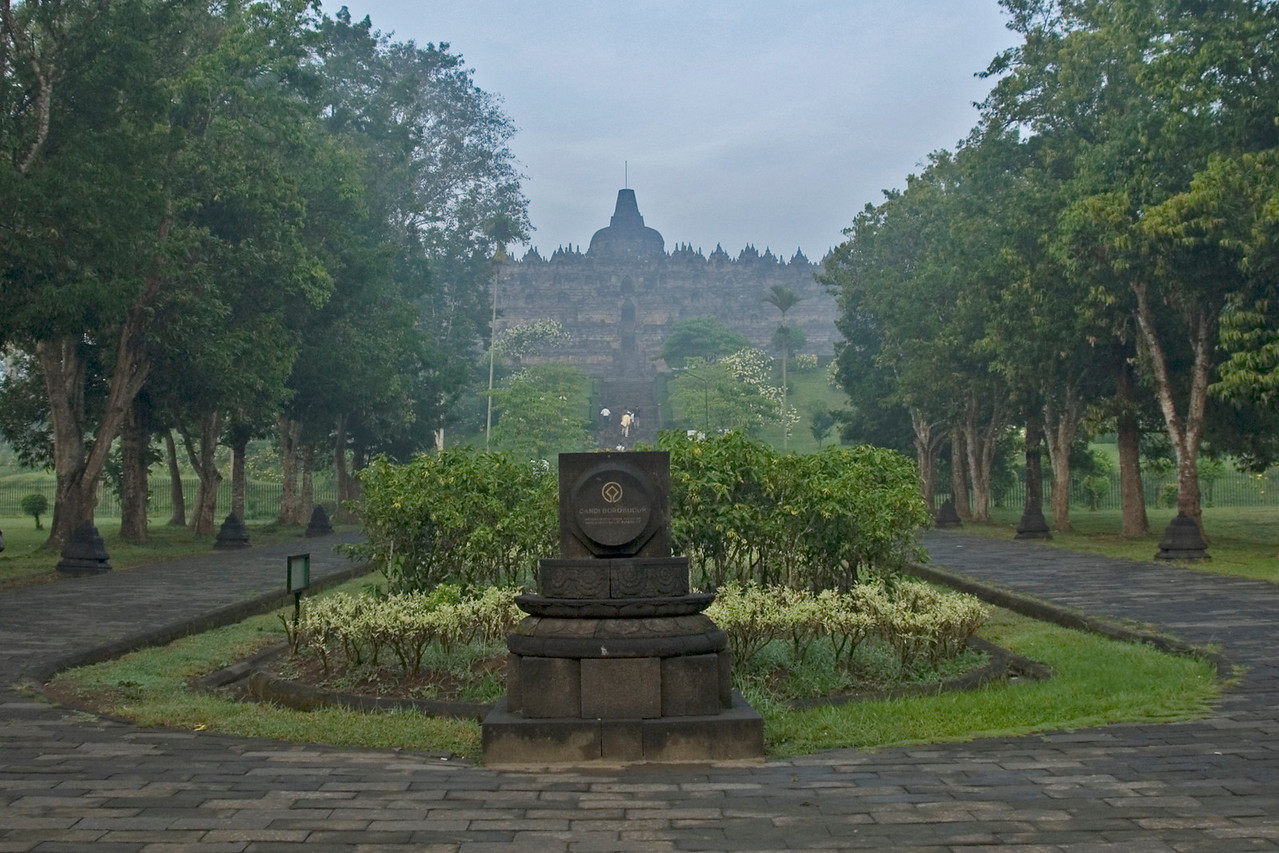 Monument at the tree-lined entrance driveway to Borobudur temple in Java, Indonesia