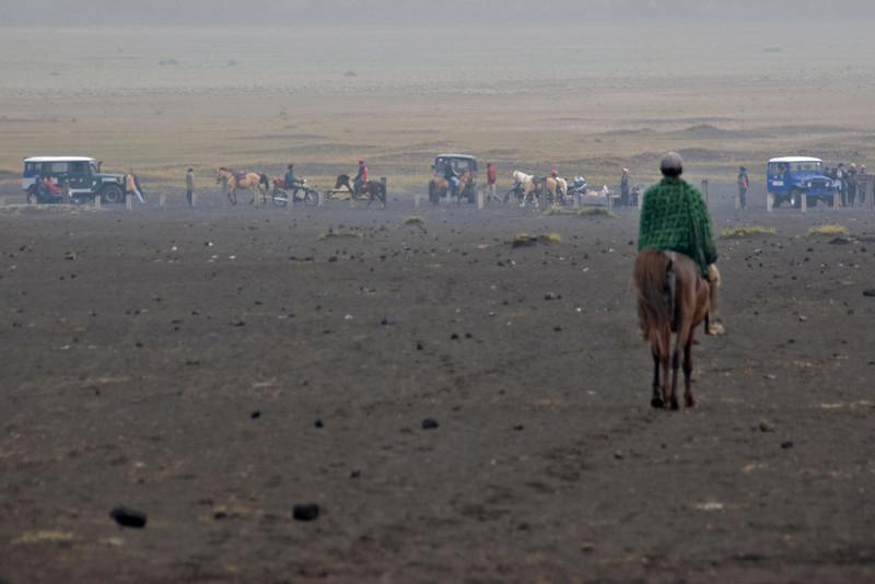 Man riding the horseback en route to Mount Bromo