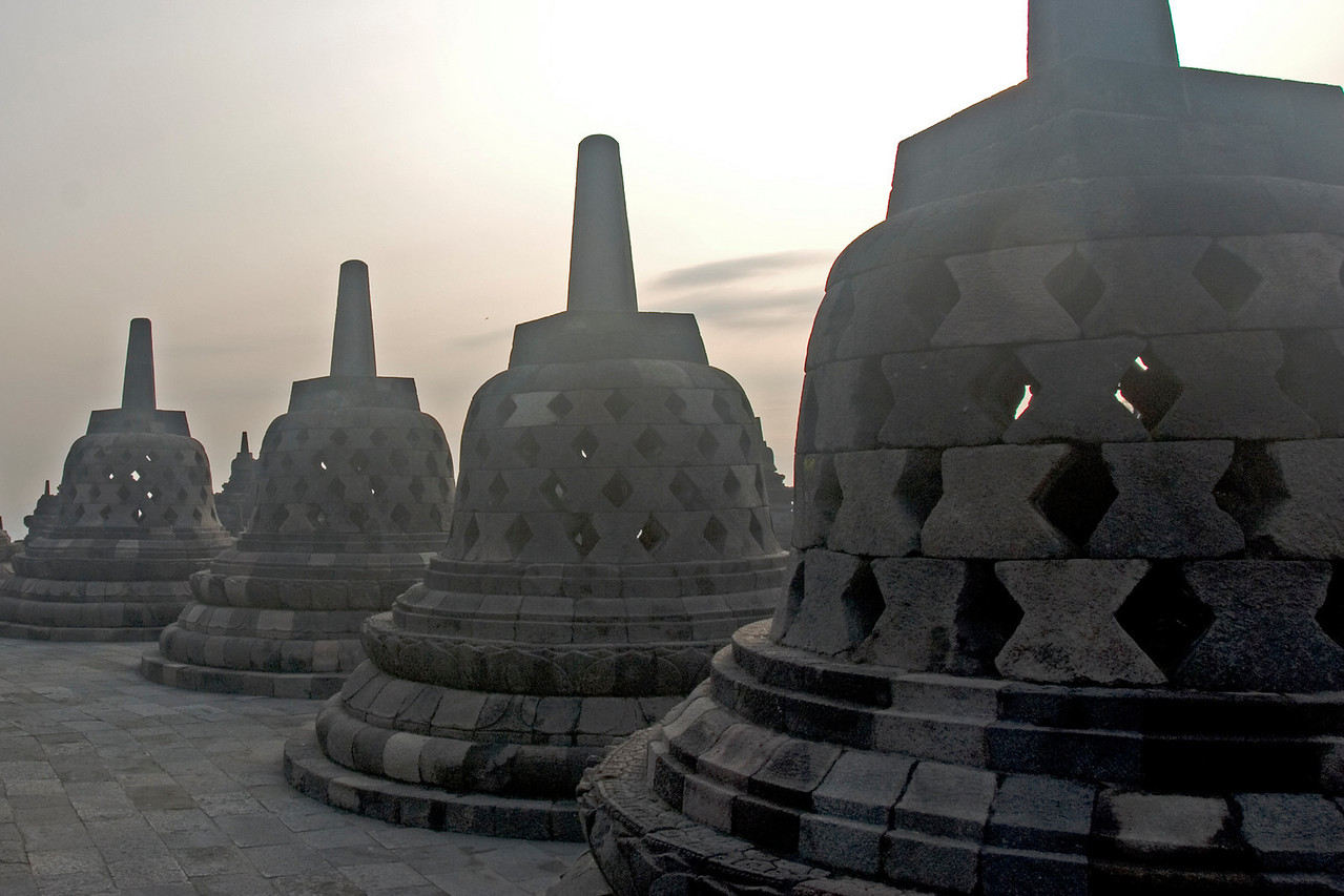 Stupas lined atop the Borobudur temple in Java, Indonesia