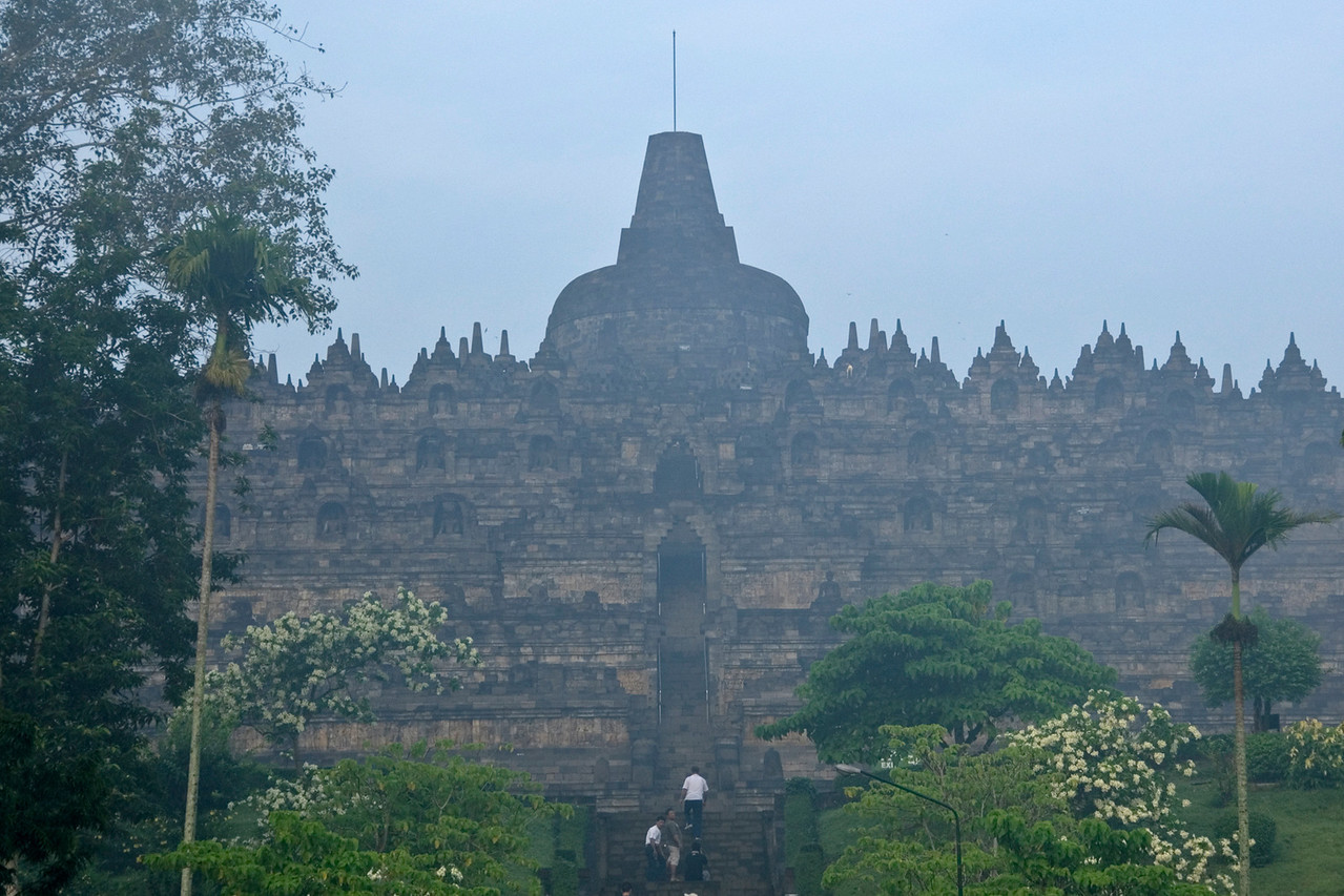 Shot of the Borobudur temple facade from afar in Java, Indonesia