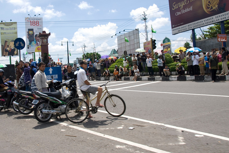 Locals waiting on the side of road along route of Suharto Funeral