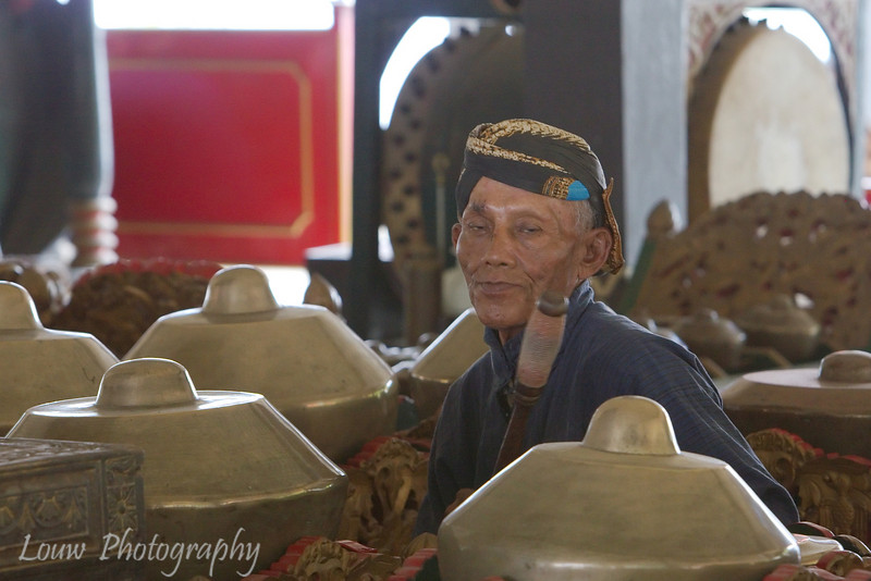 Musician playing the Bonang (Gamelan instrument) at the Sultan's Palace (Kraton), Yogyakarta, Indonesia