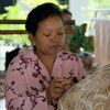 "<a target=""NEWWIN"" href=""http://en.wikipedia.org/wiki/Batik"">Batik</a> maker applying melted wax to fabric, Sultan's Palace (Kraton), Yogyakarta, Indonesia"