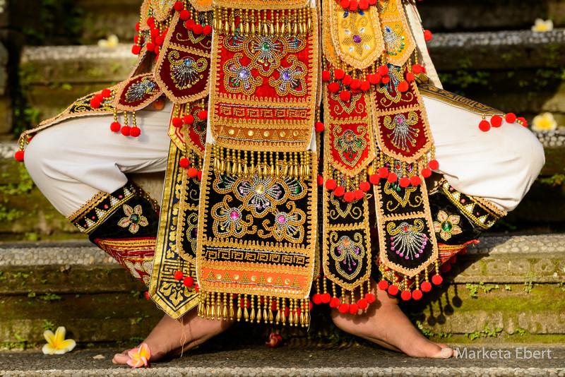 Balinese dancer wears an elaborate costume
