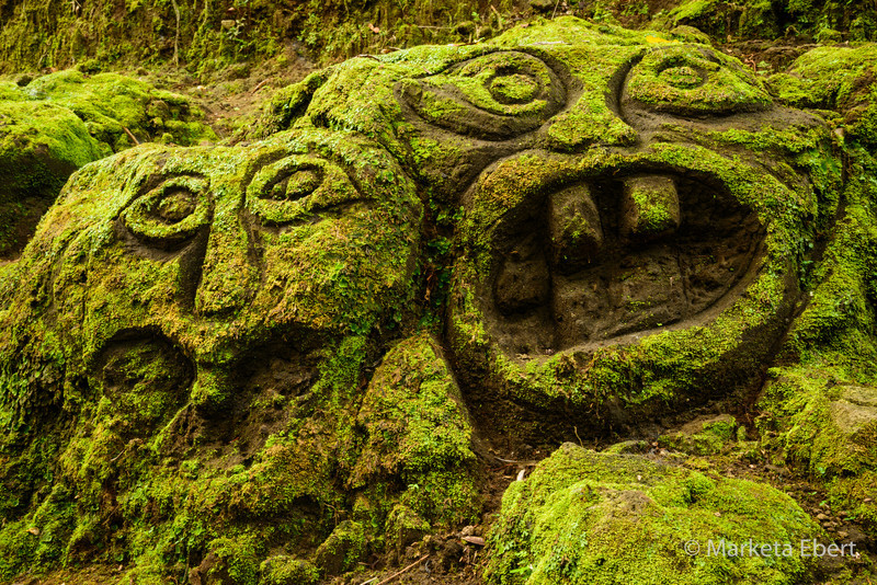 Carvings on the grounds of Elephant Cave complex in Bali.