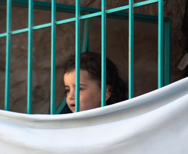 Girl peering out in Safed