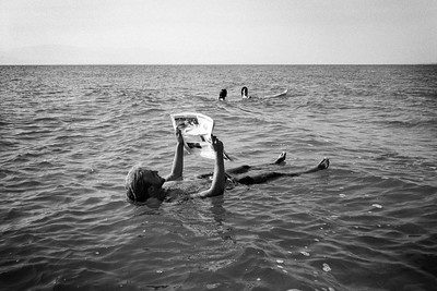 Man floating in the Dead Sea (Black and white)