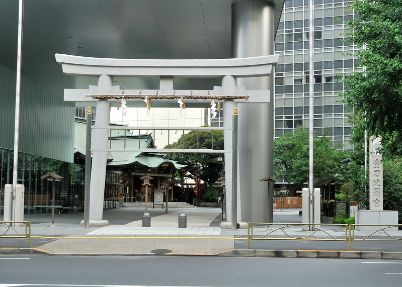 Temple and modern concrete torii gate near Toranomon subway station