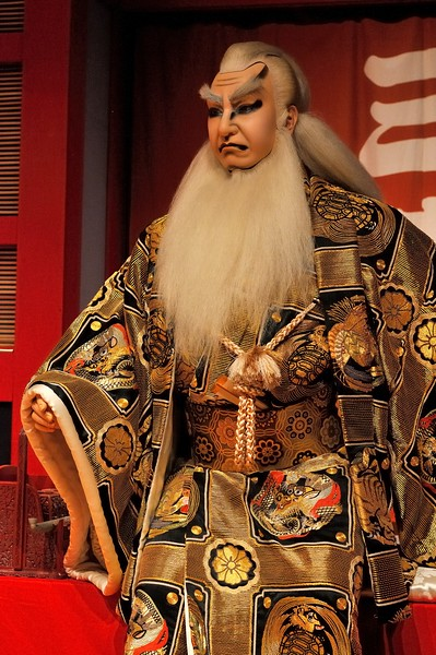Kabuki figure in traditional makeup and garb