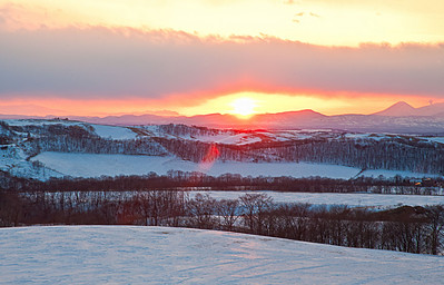 A beautiful sunset over the cold winter fields of Hokkaido Japan