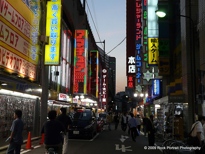 Tokyo suburbs are all littered with side alleys like this. Every street has multiple businesses in each tower, and bright neon strip signs to the left and right