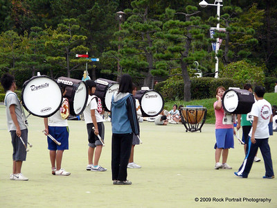 "On a nearby parade ground (???) a marching band and other useless ""opening ceremony"" related activities progressed."