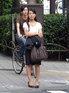 On the way to work - notice the feet stance? Very common for Japanese women.