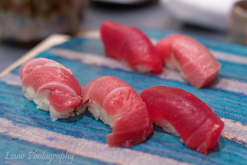 Different grades of tuna - ootoro, chutoro and akamai.  Daisan Harumi Sushi, Tokyo, Japan