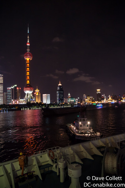 Tug pushing with Oriental Pearl Tower