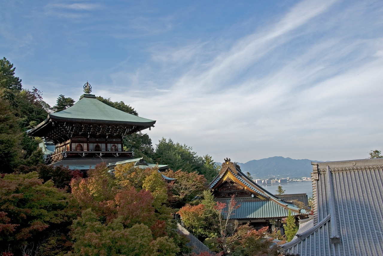 Overlooking the beautiful sky and rooftops of Daisho-in Temple in MIyajima, Japan