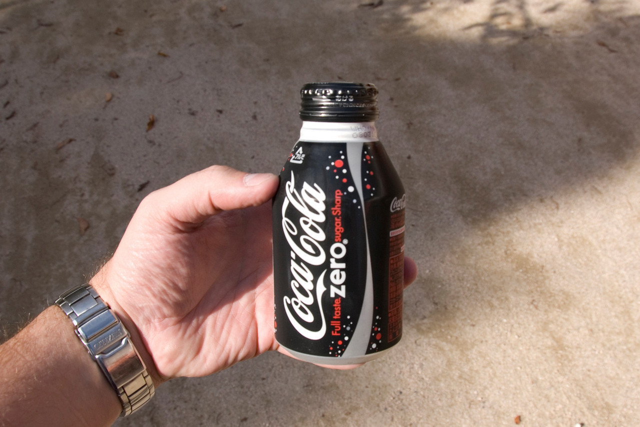 Close up shot of Coke Zero Can in hand - Japan