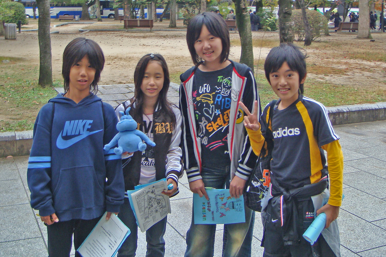 Kids posing to the camera with Skull at Peace Park in Japan