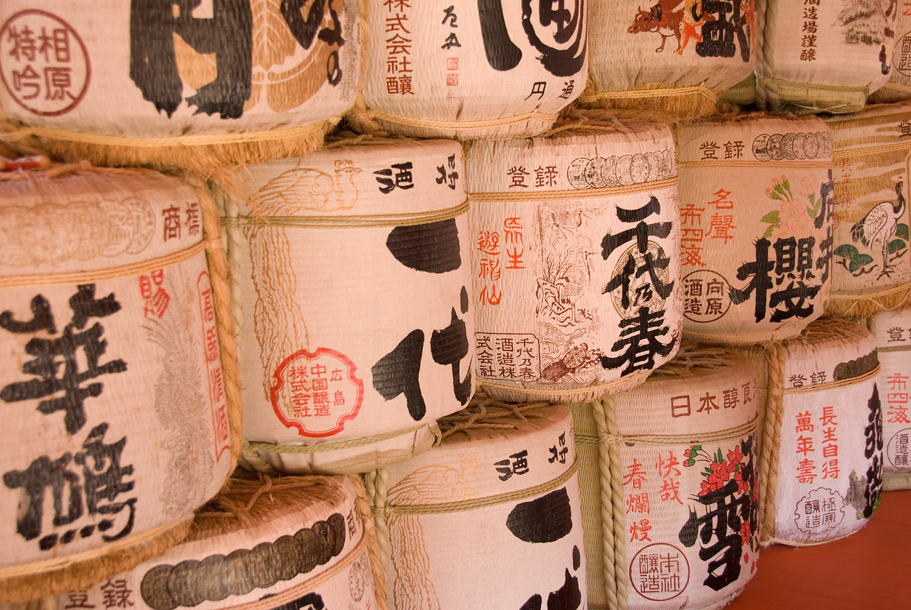 Pile of containers with Japanese inscriptions at Itsukushima Shrine in Miyajima, Japan
