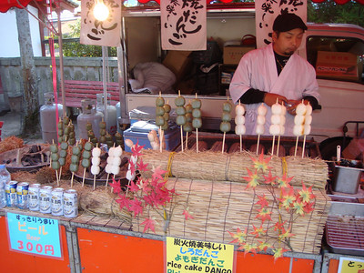 Food vendor at a stall in Miyajima, Japan