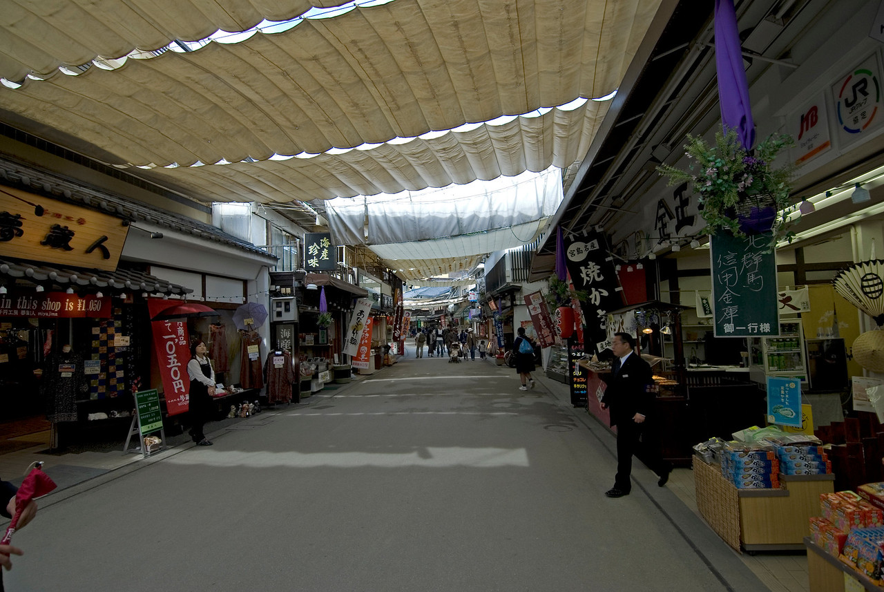 Line of stalls in the shopping district of Miyajima, Japan