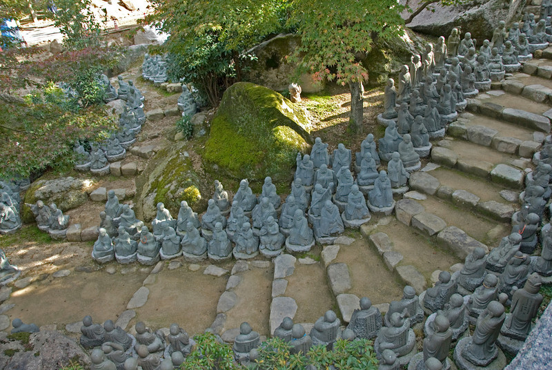 Several small Buddha statues along stairs in Daisho-in Temple - Miyajima, Japan