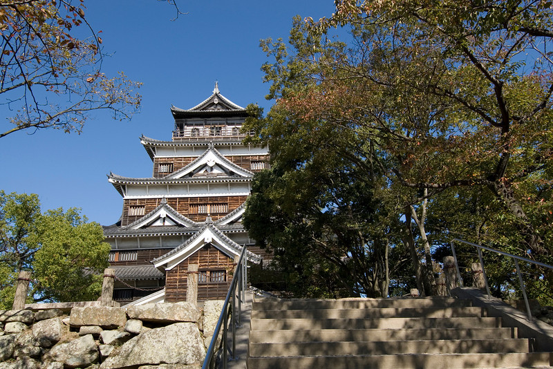 Hiroshima Castle partly covered by trees in Hiroshima, Japan