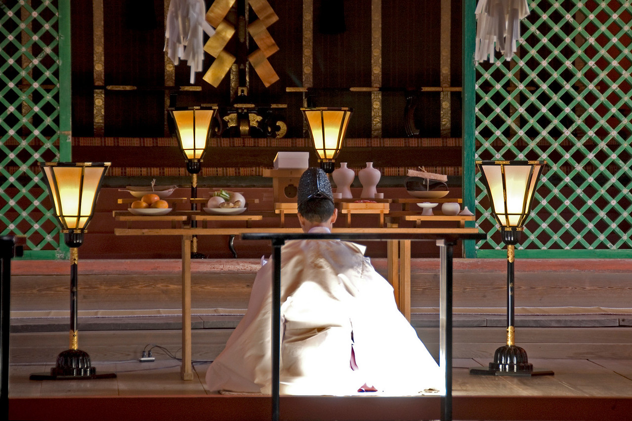 Priest kneeling during Wedding Ceremony at Itsukushima Shrine in Miyajima, Japan