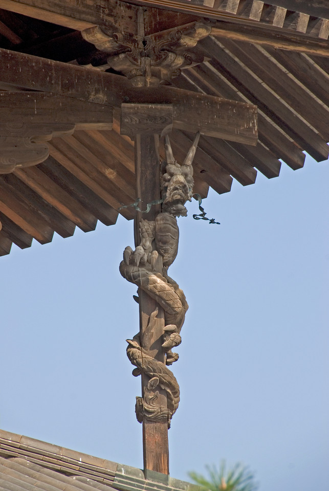 Elaborate wooden dragon sculpture at Horjuyi Temple in Japan
