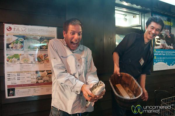 Dan holds the Fugu (blowfish) - Osaka, Japan
