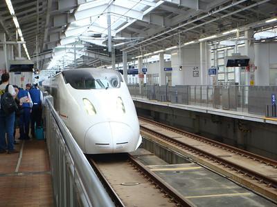 Bullet train arrives at the train station in Kagoshima, Japan