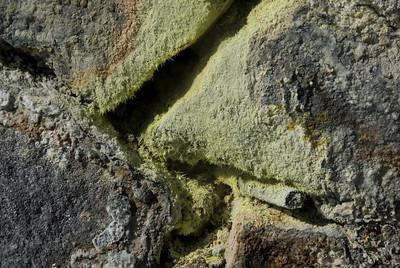 Close-up shot of sulfur covered rocks in Kirishima Mountains in Japan