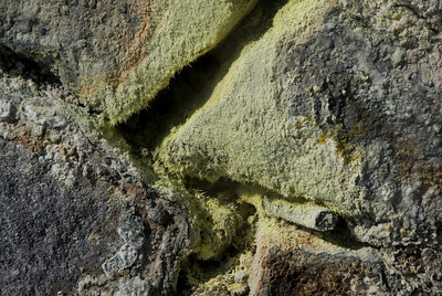 Close-up shot of sulfur covered rocks in Kirishima Mountains in Japan