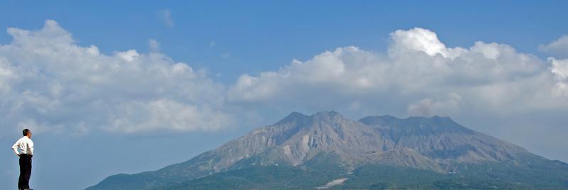 Japanese businessman looking at Mount Sakurajima in Japan