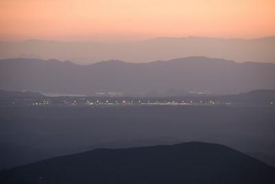 Shot of the city and mountain at sunset from Kirishima Mountain