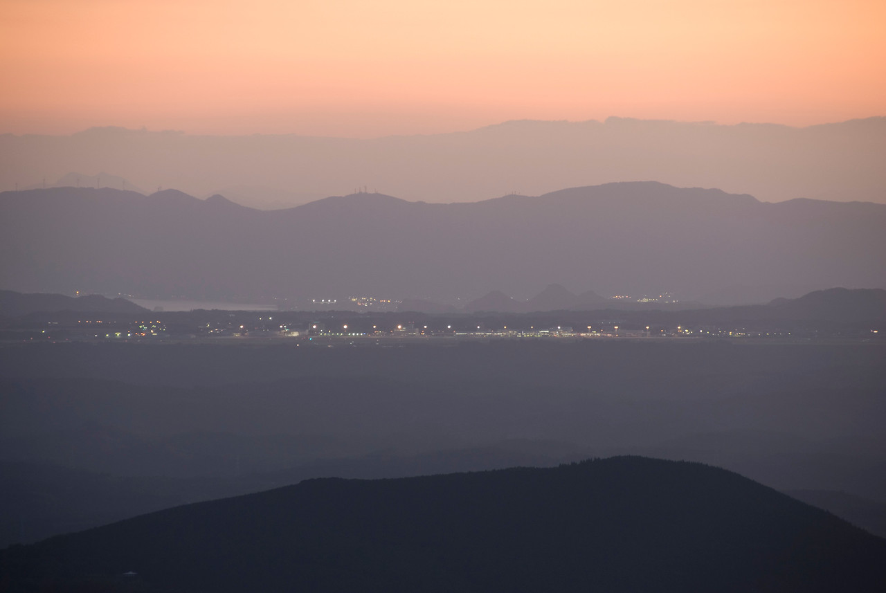 Shot of the city and mountain at sunset from Kirishima Mountain