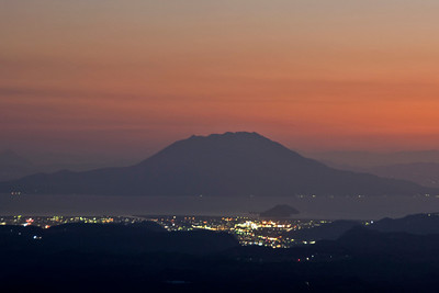 City lights and a colorful sunset in Kirishima Mountain, Japan