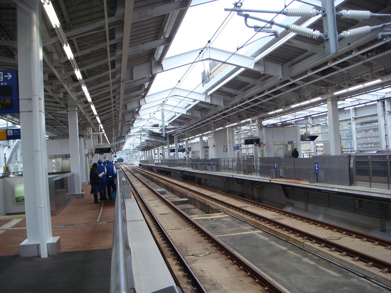 Waiting on the bullet train at train station in Kagoshima, Japan