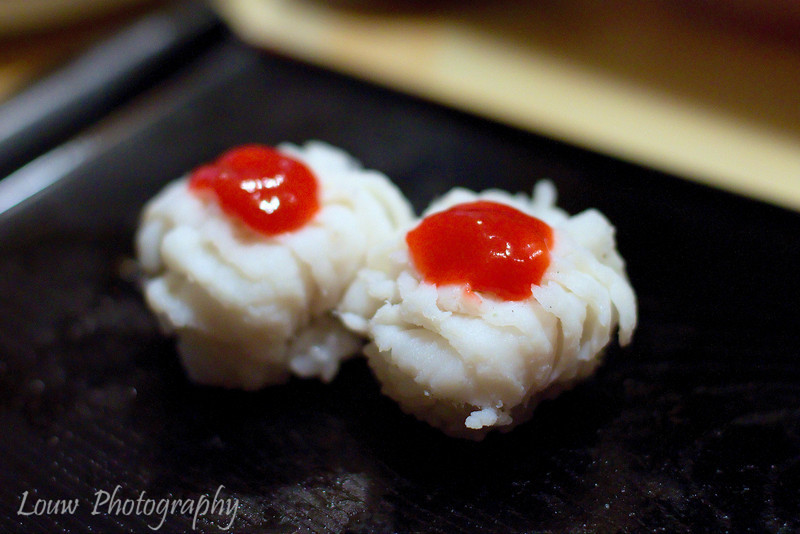 Hamo sushi with plum sauce at Koyoshi Sushi, Osaka, Japan