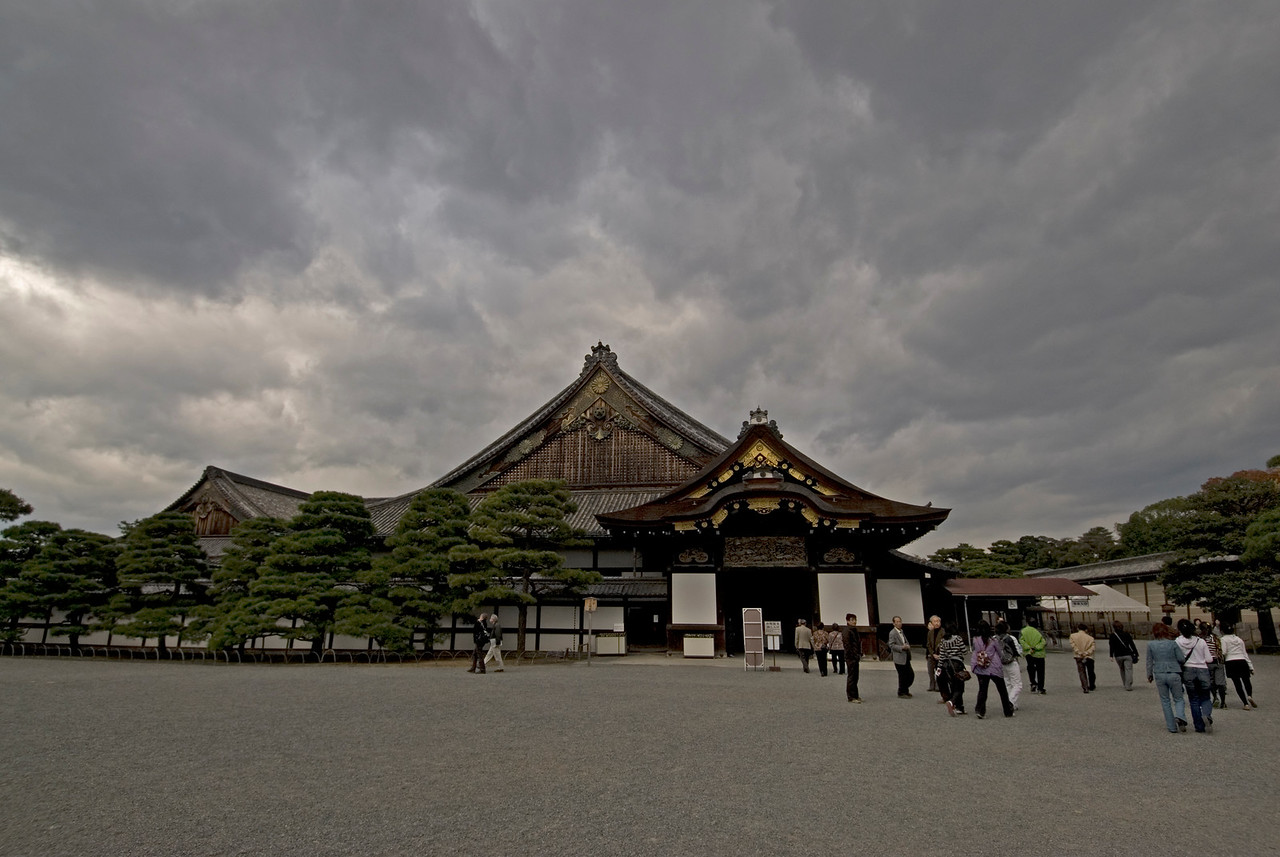 Tourists and locals on the grounds of Nijojo Castle in Kyoto, Japan